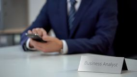 Professional business analyst chatting on smartphone, discussing business news. Stock photo royalty free stock photo