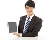 Professional business man using a tablet to display Stock Photos