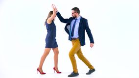 Professional business people having fun celebrating success in business in studio stock video footage