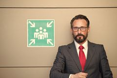 Professional business people at meeting point sign. Man in suit and red tie at sign for meeting point. Meeting point for young. Businessmen and entrepreneurs royalty free stock images