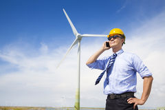 Professional business standing with wind generator Stock Images