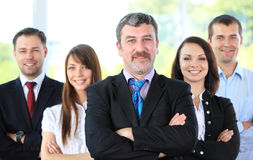 Professional business team. Group portrait of a professional business team looking confidently at camera Stock Photography