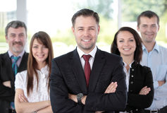 Professional business team. Group portrait of a professional business team looking confidently at camera Royalty Free Stock Photography