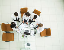 Professional business team developing a new financial strategy of the company at a work location in a modern office Stock Images