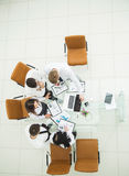 professional business team developing a new financial strategy of the company at a work location in a modern office Royalty Free Stock Photos