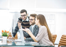 professional business team is developing a new project ,sitting behind a Desk in a modern office. Royalty Free Stock Photos