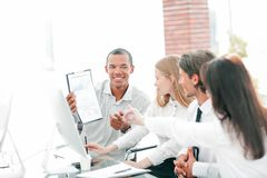 Professional business team discussing new information in the office stock photo