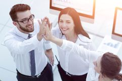 Successful business team giving each other a high five . Professional business team giving each other a high five stock photography