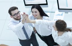 Successful business team giving each other a high five . Professional business team giving each other a high five royalty free stock photos