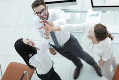 Successful business team giving each other a high five . Professional business team giving each other a high five royalty free stock image
