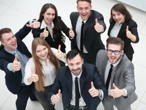 Successful business team holding up a thumbs up Royalty Free Stock Photography