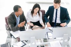 Professional business team sitting at Desk in the office stock photography