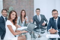 Professional business team sitting at the office Desk. Business concept royalty free stock photo