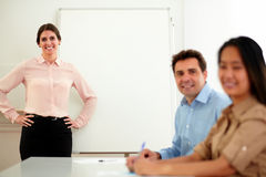 Professional business team smiling at you Stock Photos