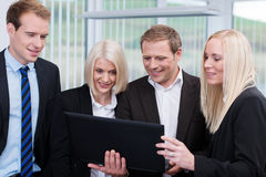 Professional business team using a laptop royalty free stock image