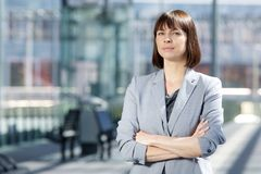 Professional business woman. Close up portrait of a professional business woman standing with arms crossed Stock Photos