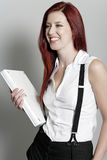Business woman holding laptop. Professional business woman holding a white laptop at work royalty free stock photos