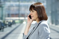 Professional business woman talking on mobile phone. Close up portrait of a professional business woman talking on mobile phone Royalty Free Stock Image