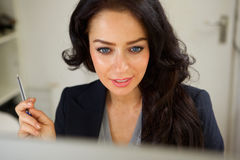 Professional business woman thinking. Close up portrait of professional business woman thinking Stock Images