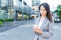 Professional business woman using mobile phone. Asian young pretty woman at outdoor Stock Image