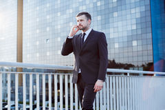 Professional businessman during business call stock image