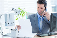 Professional businessman checking at his notebook Stock Photo