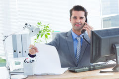 Professional businessman checking at his notebook Stock Photography