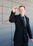 Professional businessman drawing a growth curve Stock Photography