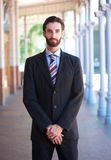 Professional businessman standing outdoors in formal suit Stock Photos