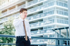 Professional businessman using smartphone talking on his phone s Royalty Free Stock Photos
