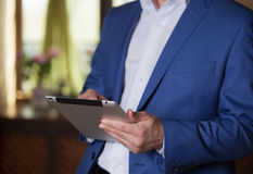 Professional businessman working at desk and using a touch scree Royalty Free Stock Photography