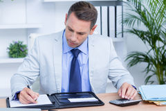 Professional businessman writing on his notebook Stock Image