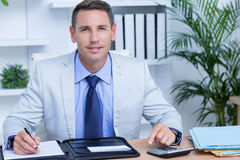 Professional businessman writing on his notebook Royalty Free Stock Image