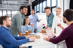 Professional businesspeople discussing and brainstorming together on workplace in office. Young professional group concept Stock Photos