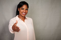 Professional businesswoman giving a hand shake Royalty Free Stock Images