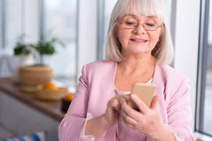 Professional businesswoman looking through her contacts Stock Photo