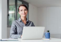 Professional businesswoman working on a computer Royalty Free Stock Photography
