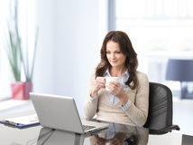 Professional businesswoman working on laptop Stock Images