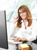 Professional businesswoman working on laptop Royalty Free Stock Photos
