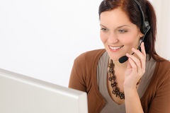 Professional call center representative woman. Look computer wear headphones Stock Photography