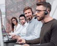 Professional call center staff in the workplace. Photo with copy space stock images