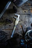 Calipers tool on table.Trammel ruler top view Royalty Free Stock Photos