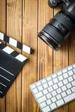Professional camera,computer keyboard and clapper board. Stock Photography