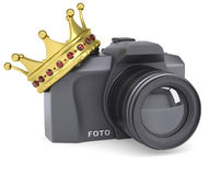 Professional camera and gold crown Stock Photo