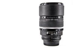 Professional camera lense. Nikkon 105 mm DC professional camera lense isolated on white background Royalty Free Stock Photography
