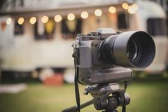 Professional camera put on tripod. With beautiful background royalty free stock photos