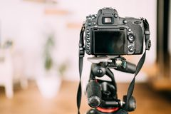 professional camera sitting on tripod and taking photographs. Interior design photography gear stock photos