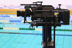 Professional camera for survey of video. In swimming pool in sporting complex stock photos