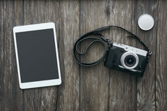 Professional camera and tablet Stock Photography