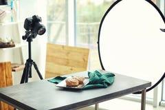 Professional camera on tripod stock photos